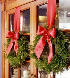China cabinet Christmas holiday, christmas wreaths, china cabinets, window, ribbon, christma decor, cabinet doors, bow, christmas ideas