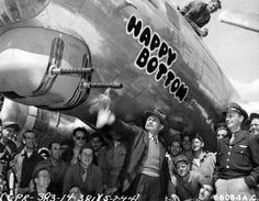 """Edward G. Robinson christens Boeing B-17 Flying Fortress """"Happy Bottom"""" of the 381st Bomb Group at 8th Air Force Station 167 in England, 5 July 1944."""