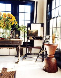 The Celebrity Guide to Summer in Montauk // easel, painted white floors, artist's workshop
