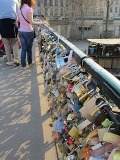 Paris love bridge. You hang locks on it with the name of you & your boyfriend/girlfriend/bestfriend then throw the key into the river