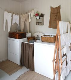 Love this laundry room especially the drying rack