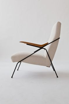 Pierre Guariche; Enameled Metal and Oak Arm Chair, 1950s.