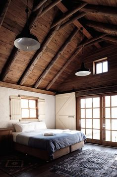 Rustic master bedroom with high ceilings.