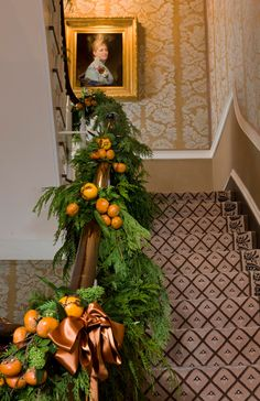 Festive Holiday Staircases and Entryways - Traditional Home® fruit, houses, orang, stairway, holidays, christmas decorating ideas, stair runners, christmas garlands, traditional homes