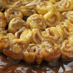 Mini Caramel Rolls ~ Here's the perfect warm treat for pajama-clad family mornings. These ooey-gooey baked rolls come together in moments—thanks to a tube of refrigerated crescent rolls—and disappear just as quickly.