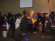 My husband and I built this Wheel of Fortune Game for a Halloween Event. Well, we built many games. My husband used to build furniture and knows how to restore it, so it was great we could build games for the event by scratch! It was super fun! We even had our own Pat and Vanna there to greet people! Well, it wasn't really Pat and Vanna, it was more like the their look-a-like's. Wooden Games Built by www.wicksncandlesticks.com #wicksncandlesticks