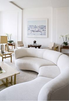 A Parisian apartment, designed by Pierre Yovanovitch: A Vladimir Kagan sofa and Edward Wormley armchairs, both c.1950s