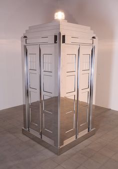 """This is Mark Wallinger's """"Time and Relative Dimensions in Space 2001″, a life-sized mirrored model of the TARDIS from Doctor Who which at certain angles seems to blend into its environment. It was exhibited at The Hayward Gallery in February 2009."""