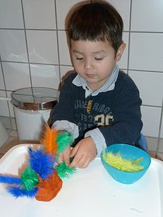"""Practising the pincer grip with a feathers & playdough ("""",)"""