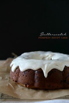 Butterscotch Pumpkin Bundt Cake: Sweet pumpkin cake filled with butterscotch chips and covered in a thick cream cheese glaze.