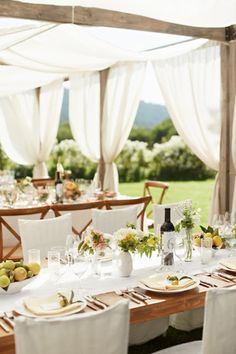 Lightweight fabric draped over a wooden frame creates a romantic atmosphere but also a shelter from direct sunshine over your guests