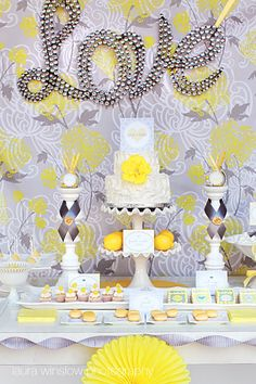 yellow and gray wedding dessert table