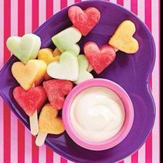 Melons on a Popsicle stick, yogurt on the side. Use cookie cutters to make shapes