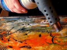 Torching the encaustic paint..