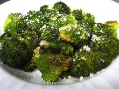 Oven Roasted Broccoli: 1 bunch broccoli, cut into pieces. 1/4 cup olive oil, 2-4 cloves garlic, minced,   1/4 tsp red pepper flakes (optional), salt and pepper to taste, 1/4 cup parmesan. Bake at 400 degrees for 15 minutes.