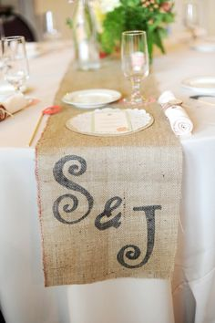 Burlap table runner. Could calligraphy initials with black sharpie.