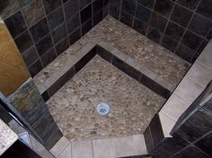 I would love my shower floor to be made of river pebbles!