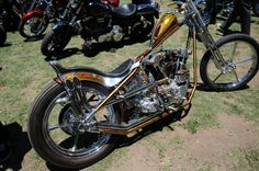 super skinny knucklhead 70s style custom chopper with tiny peanut tank, metal flake paint job, springer front end and chrome five-spoke invader rims at Born Free 4
