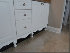 What a great fakeout. Regular bathroom cabinets with a bit of trim and fake legs....instantly looks custom!