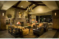 The community center at Solera at Stallion Mountain by Del Webb: Rustic stone and beams, leather sofas and a stone fireplace. Active adult new homes. Las Vegas, NV.
