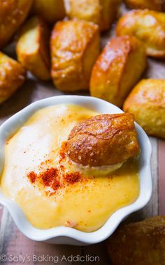 Soft Pretzel Bites with Spicy Cheese Sauce - this recipe is so simple. And the cheese sauce is to die for! sallysbakingaddiction.com
