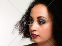 woman with curly hair wearing make up. - Close-up of a woman with curly hair wearing make up, Model: Taylor Chmiel MUA: Irene Prowell