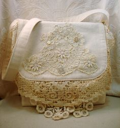 A purse I made using regular old drop cloth fabric from the hardware store...  wedding lace, vintage watch faces and beautiful old buttons ~