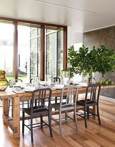 Our dining room will have these similar floor to ceiling windows and this similar floor... I love this dining table to go with