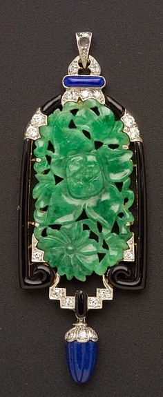 Art Deco Jadeite, Lapis, Enamel, and Diamond Pendant, the floral and foliate carved jadeite tablet within a black enamel frame, suspending a gadrooned lapis drop, old European, full, and single-cut diamond melee highlights, millegrain accents, platinum-topped gold mount, lg. 2 1/2 in. <3