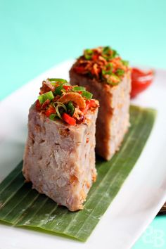 Yam Cake Recipe (Or Kuih) recipe - This is a popular snack amongst the Malaysian and Singaporean communities, and is basically a steamed cake made from yam pieces, dried prawns and rice flour. It is then topped with deep fried shallots, spring onions, chillis and dried prawns, and usually served with a chilli dipping sauce. #malaysian #snack