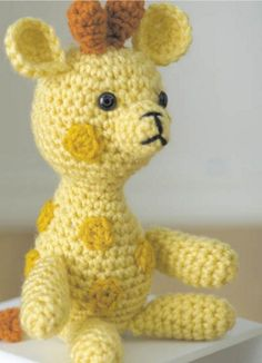 This DIY giraffe is the perfect knit project for a baby shower gift!