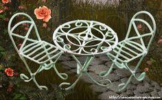 A three piece miniature white bistro furniture set for your miniature fairy gardens.