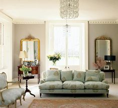 living rooms - gray wall mirror chandelier french green blue sofa ornate mirrors black pedestal tables  french chic living room from brocantegirl's