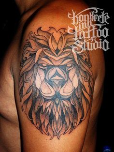 stained glass styled lion tattoo