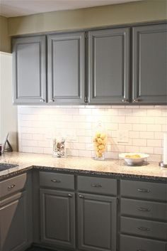 Gray cabinets in Bedford Gray by Martha Stewart and white subway tile with gray grout.