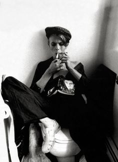 David Bowie. Always picking out the weird stuff, but is he wearing jellies?