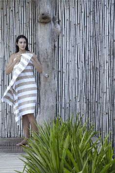 outdoor shower, piping behind tree trunk, slatted privacy wall