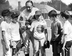Hall of Fame pitcher Bob Feller was in Omaha on June 12, 1968, to conduct youth baseball clinics. He's shown here at Christie Heights with, from left, Tom Bojanski, Jerry Jacobsen, Mark Kleine, Dan Salem and Tim Wagman. The clinics were sponsored by the Parks and Recreation Department, the American Baseball Coaches Association and The World-Herald. THE WORLD-HERALD
