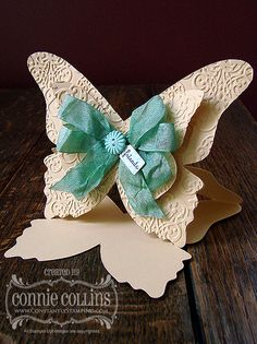 Butterfly Easel card ... gorgeous .... huge vanilla butterfly with textured wings ... fluffy, three loop bow in aqua ... luv it!!!