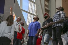 The New York Giants look up at the tridents upon entering the 9/11 Museum.