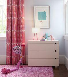 Girl's bedroom with floor length drapes, modern dresser and shag rug