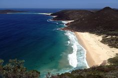 Samurai Beach, Australia Samurai Beach is a 1km-stretch at Port Stephens in New South Wales. Situated in Tomaree National Park, the beach is protected by lush greenery and sand dunes and marked by rocky outcrops at either end.  Dolphins swim off the coast in the sparkling blue waters. Don't look for snack bars or toilets; this is a slice of natural Australia.