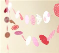 Did you know you can sew paper? Just mix some hearts, circles, and doilies in different patterns, and sew together to make a beautiful Valentine's Day decoration!
