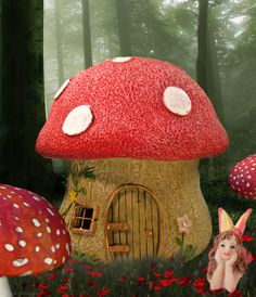 Red mushroom fairy house in the fairy garden.