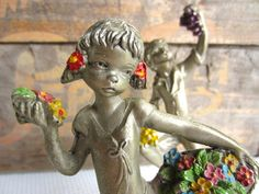 Vintage Peltro Spring and Autumn Pewter Figurines by corrnucopia