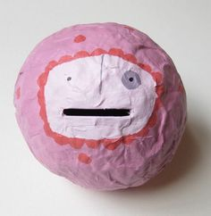 Money balls! Made by applying paper mache to a balloon. Great way to encourage kids to save money and there's no way to use their savings until they are ready to break their money ball.