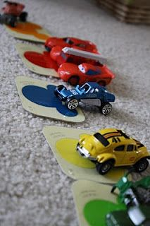 Learning colors by playing with cars