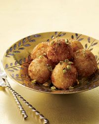 Fried Goat Cheese Balls with Honey | Club soda lightens the egg batter that coats the cheese, and a double-coating of panko crumbs amplifies the crunch.