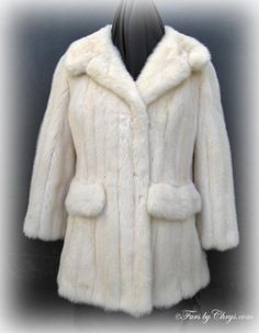SOLD! Vintage Off-White Mink Jacket #OM702; Excellent Condition; 0 - 4 Misses or Petite (up to size 6 if eyes are moved). This is a beautiful vintage genuine natural off-white mink fur jacket. It has a Marshall Field and Company label as well as Hauliuetrigere label, so you know this is a couture piece.  It features a large notched collar and decorative pocket flaps. The sleeves are shorter, stylish 3/4 length. This is one of those rare enchanting vintage mink furs that will make you swoon!