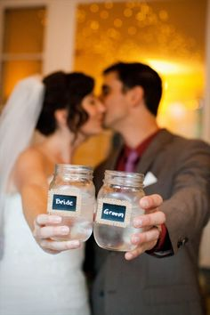 20 things to do with Mason Jars at your wedding: mason jar escort card drinking glasses (photo by jenna danielle)